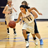 Holy Family's Lindsey Chavez dribbels the ball down court against Mountain Range during Thursday's game at Holy Family.<br /> <br /> November 29, 2012<br /> staff photo/ David R. Jennings