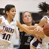 Holy Family 's Katie Chavez, left, and Lindsey Chavez grab the ball against Mountain Range's Lauren Bohan during Thursday's game at Holy Family.<br /> <br /> November 29, 2012<br /> staff photo/ David R. Jennings