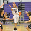 Holy Family's Katie Chavez passes the ball over Mountain Range during Thursday's game at Holy Family.<br /> <br /> November 29, 2012<br /> staff photo/ David R. Jennings