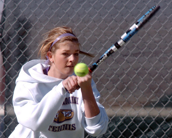 Holy Family's Stephanie Giltner returns the ball to Niwot's Morgan Fitzgerald during the #2 singles match on Tuesday at Niwot.<br /> March 22, 2011<br />  staff photo/David R. Jennings