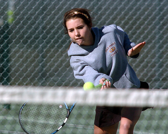 Holy Family's Claire Donovan returns the ball to Niwot's Morgan Mulshine during the #3 singles match on Tuesday at Niwot.<br /> March 22, 2011<br />  staff photo/David R. Jennings