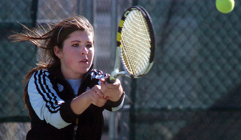 Doubles partner Mary Caldwell, Holy Family, returns the ball to Niwot's  Alli Brooks and Amanda Rutherford during Tuesday's #1 doubles match at Niwot. <br /> March 22, 2011<br />  staff photo/David R. Jennings
