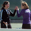 Holy Family's #1 doubles team Mary Caldwell, left, and Madi Gosselin give each other the high five while playing Niwot's Alli Brooks and Amanda Rutherford during the match on Tuesday at Niwot.<br /> March 22, 2011<br />  staff photo/David R. Jennings
