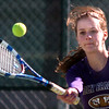 be0327htenn07<br /> Doubles partner Madi Gosselin, Holy Family, returns the ball to Niwot's  Alli Brooks and Amanda Rutherford during Tuesday's #1 doubles match at Niwot. <br /> March 22, 2011<br />  staff photo/David R. Jennings