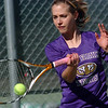 Holy Family's Elizabetta Dewitt returns the ball to Niwot's Wanda Holopainen during the#1 singles match on Tuesday at Niwot.<br /> March 22, 2011<br />  staff photo/David R. Jennings