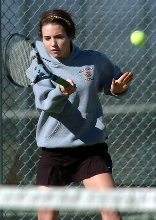 Holy Family's Claire Donovan returns the ball to Niwot's Morgan Mulshine during the#3 singles match on Tuesday at Niwot.<br /> March 22, 2011<br />  staff photo/David R. Jennings
