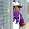 Glen Ramos, Holy Family's coach, coaches form the dugout  during play against Peak to Peak at Broomfield Industrial Park on Saturday.<br /> October 17, 2009<br /> Staff photo/David R. Jennings