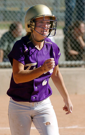 Beth Peterson, Holy Family, runs to first during play against Peak to Peak at Broomfield Industrial Park on Saturday.<br /> October 17, 2009<br /> Staff photo/David R. Jennings