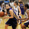 Molly Coogan, Holy Family, drives the ball past Khadijah Sayyid, Peak to Peak during Friday's game at Peak to Peak.<br /> <br /> January 08, 2010<br /> Staff photo/David R. Jennings