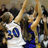 Stephanie Giltner, Holy Family, shoot to the basket past Caroline Clark, Peak to Peak during Friday's game at Peak to Peak.<br /> <br /> January 08, 2010<br /> Staff photo/David R. Jennings