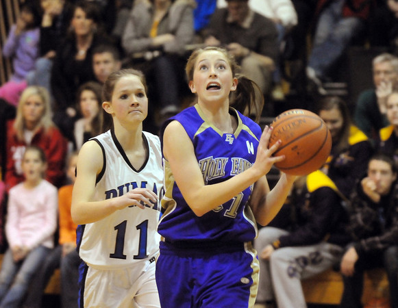 Sarah Talamantes, Holy Family, eyes the basket past Ally Hatch, Peak to Peak during Friday's game at Peak to Peak.<br /> <br /> January 08, 2010<br /> Staff photo/David R. Jennings