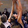 Stephanie Giltner, Holy Family, fights for the ball with Caroline Clark,  Peak to Peak during Friday's game at Peak to Peak.<br /> <br /> January 08, 2010<br /> Staff photo/David R. Jennings