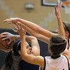 Molly Coogan, Holy Family, fights for possession of the ball with Caroline Clark and Ally Hatch, Peak to Peak durng Friday's game at Peak to Peak.<br /> <br /> January 08, 2010<br /> Staff photo/David R. Jennings