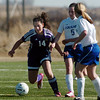 Holy Family's Danielle Marcello moves the ball past Resurrection Church's Nichole Stevenson during Wednesday's game in Loveland.<br /> March 22, 2011<br />  staff photo/David R. Jennings