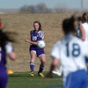 Holy Family's Kendall Russell makes a corner kick against Resurrection Church during Wednesday's game in Loveland.<br /> March 22, 2011<br />  staff photo/David R. Jennings