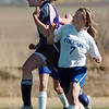 Holy Family's Heidi Hanson does a header past Resurrection Church's Meagan Bush during Wednesday's game in Loveland.<br /> March 22, 2011<br />  staff photo/David R. Jennings