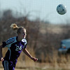 Holy Family's Micaela Blanchard does a header moving the ball downfield against Resurrection Church during Wednesday's game in Loveland.<br /> March 22, 2011<br />  staff photo/David R. Jennings