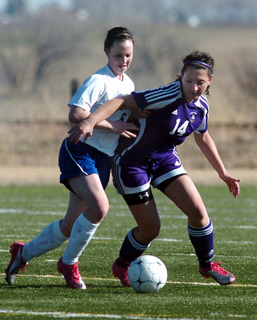 Holy Family's Danielle Marcello fights for control of the ball with  Resurrection Church's Audrey Isabelle during Wednesday's game in Loveland.<br /> March 22, 2011<br />  staff photo/David R. Jennings