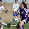 Holy Family's Danielle Marcello perpares to block a kick by Resurrection Church's Lindsay Weaver during Wednesday's game in Loveland.<br /> March 22, 2011<br />  staff photo/David R. Jennings