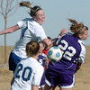 Holy Family's Amy Baumberger does a header towards the goal against Resurrection Church's Lindsay Weaver and Sarah Wallman during Wednesday's game in Loveland.<br /> March 22, 2011<br />  staff photo/David R. Jennings
