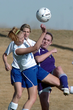 Holy Family's Heidi Hanson collides with Resurrection Church's Allison Weaver while moving the ball towards the goal during Wednesday's game in Loveland.<br /> March 22, 2011<br />  staff photo/David R. Jennings