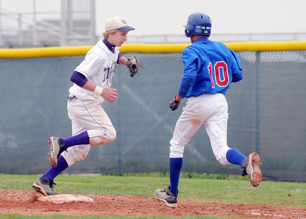 Holy Family's Matt Erb beats Sheridan's Joseph Pasillas to first base during Saturday's 3A district game at Holy Family.<br /> <br /> May 12, 2012 <br /> staff photo/ David R. Jennings