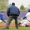 Under the watchful eyes of the umpire, Holy Family's Jarred DeHerrera slides to second base agianst Sheridan's Adrian Alvarado during Saturday's 3A district game at Holy Family.<br /> <br /> May 12, 2012 <br /> staff photo/ David R. Jennings
