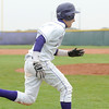 Holy Family's Jarred DeHerrera runs to home plate to score a run against Sheridan during Saturday's 3A district game at Holy Family.<br /> <br /> May 12, 2012 <br /> staff photo/ David R. Jennings