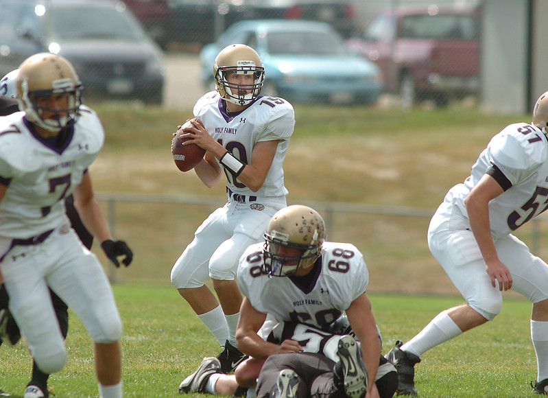 Holy Family quarterback Zach Langfield looks for an open receiver  during Saturday's game against Skyview at George Ditirro Stadium in Thornton.<br /> October 9, 2010<br /> staff photo/David R. Jennings