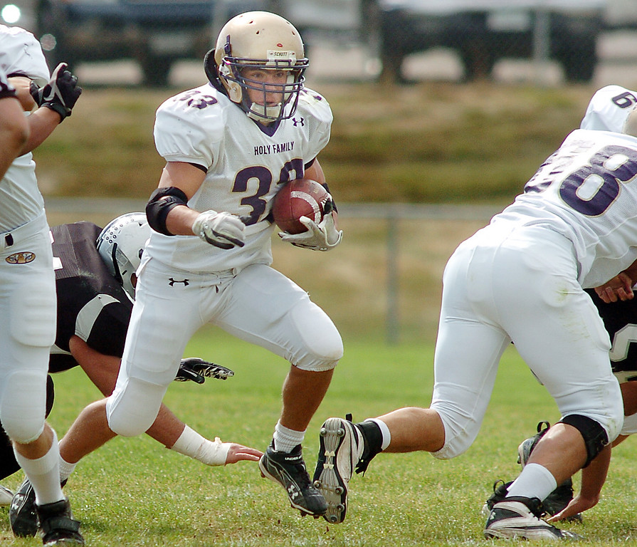 Holy Family's Connor Clay looks for an opening in the line away from Skyview during Saturday's game at George Ditirro Stadium in Thornton.<br /> October 9, 2010<br /> staff photo/David R. Jennings