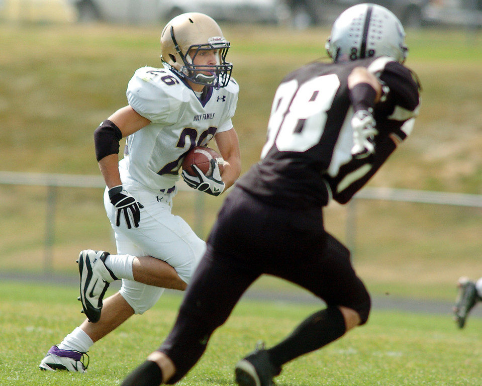 Holy Family's Anthony Pugliese runs the ball downfield past Drew Martinez, Skyview, during Saturday's game at George Ditirro Stadium in Thornton.<br /> October 9, 2010<br /> staff photo/David R. Jennings