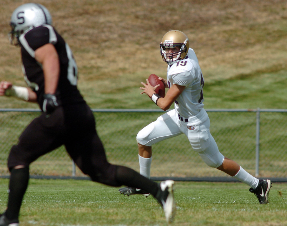 Holy Family's quarterback Zach Langfield runs the ball against Skyview during Saturday's game at George Ditirro Stadium in Thornton.<br /> October 9, 2010<br /> staff photo/David R. Jennings
