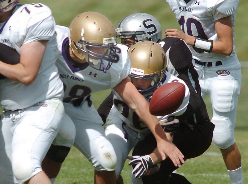 Holy Family's Matthew Miller, center,  scrambles to recover a fumble against Skyview during Saturday's game at George Ditirro Stadium in Thornton.<br /> October 9, 2010<br /> staff photo/David R. Jennings