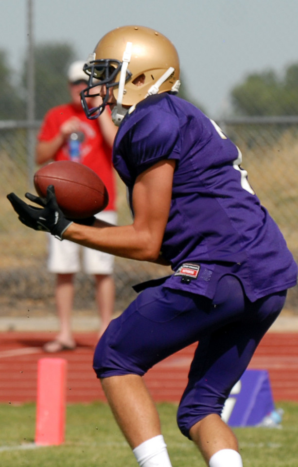 Holy Family's Kyle Munoz catches a pass for a touchdown against Steamboat Springs during Satuday's game at Mike G. Gabriel Stadium.<br /> <br /> September 4, 2010<br /> staff photo/David R. Jennings