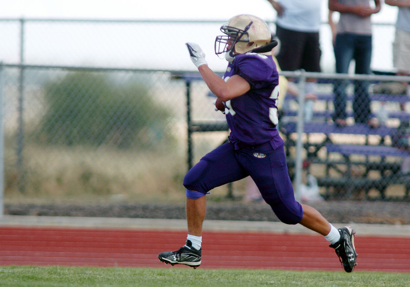 Connor Clay, Holy Family, runs to the end zone to score against Steamboat Springs during Satuday's game at Mike G. Gabriel Stadium.<br /> <br /> September 4, 2010<br /> staff photo/David R. Jennings