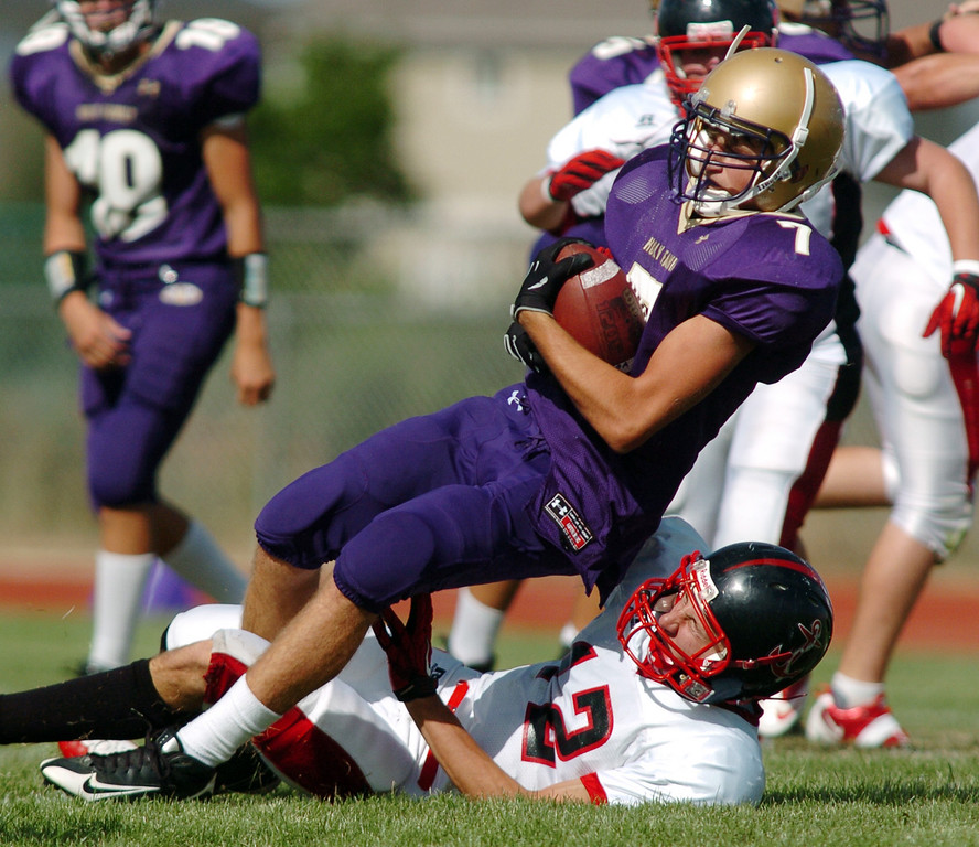 Holy Family's Kyle Munoz is tackled by Brandon Clark, Steamboat Springs, during Satuday's game at Mike G. Gabriel Stadium.<br /> <br /> September 4, 2010<br /> staff photo/David R. Jennings