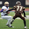 Holy Family's quarterback David Sommers carries the ball against Thomas Jefferson's Corbin Sells during Saturday's game at Denver Public Schools Stadium.<br /> October 6, 2012<br /> staff photo/ David R. Jennings