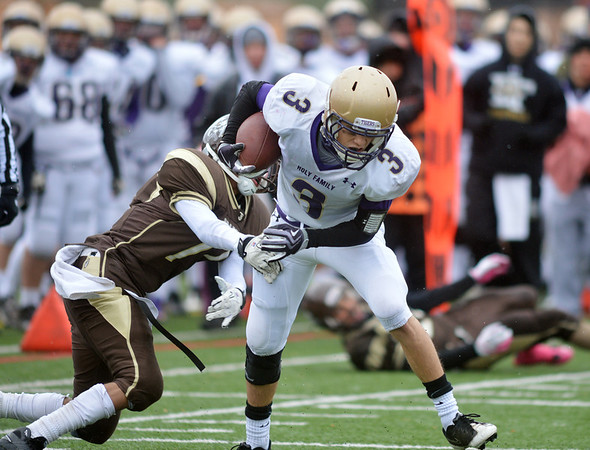 Holy Family's Tyler Hsin breaks a tackle by  Thomas Jefferson's Sheik Kamara during Saturday's game at Denver Public Schools Stadium.<br /> October 6, 2012<br /> staff photo/ David R. Jennings