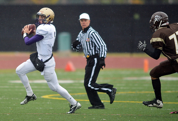 Holy Family's quarterback David Sommers gets ready to pass against Thomas Jefferson during Saturday's game at Denver Public Schools Stadium.<br /> October 6, 2012<br /> staff photo/ David R. Jennings