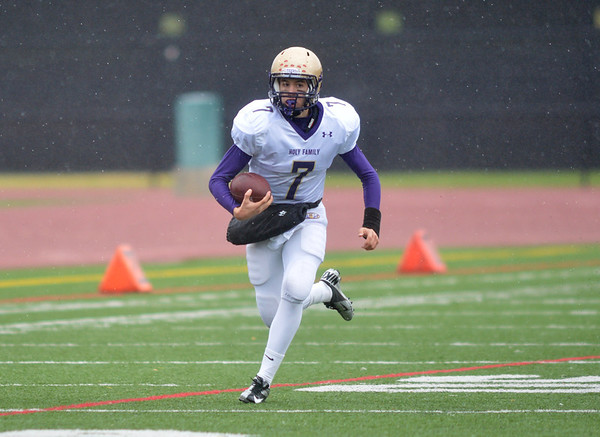 Holy Family's quarterback David Sommers runs the ball downfield against Thomas Jefferson during Saturday's game at Denver Public Schools Stadium.<br /> October 6, 2012<br /> staff photo/ David R. Jennings