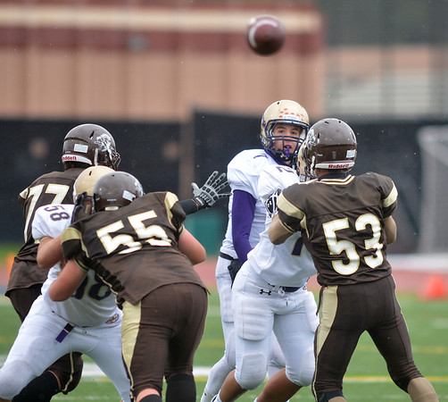 Holy Family's quarterback David Sommers  throws a pass over Thomas Jefferson's Ben Marcus Allen during Saturday's game at Denver Public Schools Stadium.<br /> October 6, 2012<br /> staff photo/ David R. Jennings