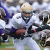 Holy Family's Tyler Hsin runs through the Thomas Jefferson defensive line during Saturday's game at Denver Public Schools Stadium.<br /> October 6, 2012<br /> staff photo/ David R. Jennings