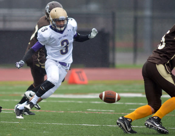 Holy Family's Tyer Hsin scrambles after a fumbled Thomas Jefferson ball during Saturday's game at Denver Public Schools Stadium.<br /> October 6, 2012<br /> staff photo/ David R. Jennings