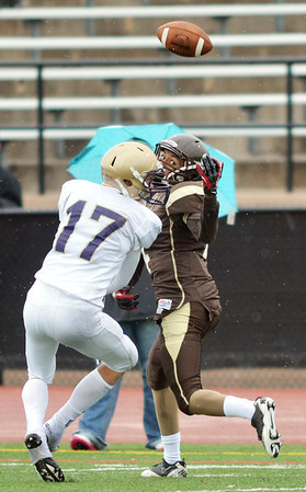Holy Family's Jake Shepherd breaks up a pass to Thomas Jefferson's Abraham Woldu during Saturday's game at Denver Public Schools Stadium.<br /> October 6, 2012<br /> staff photo/ David R. Jennings