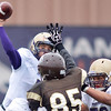 Holy Family's quarterback David Sommers throws a pass over the advancing Toby Scott, Thomas Jefferson during Saturday's game at Denver Public Schools Stadium.<br /> October 6, 2012<br /> staff photo/ David R. Jennings