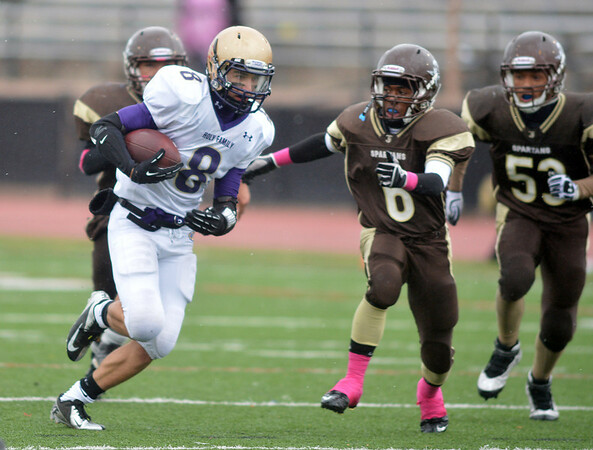 Holy Family's Chuck Hollwedel carries the ball against Thomas Jefferson during Saturday's game at Denver Public Schools Stadium.<br /> October 6, 2012<br /> staff photo/ David R. Jennings