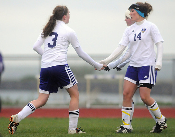 Holy Family's Heidi Hanson, left, is congratulated by Rachel Boothe after scoring a goal against Valley High during Tuesday's game at Holy Family.<br /> May 11, 2010<br /> Staff photo/ David R. Jennings