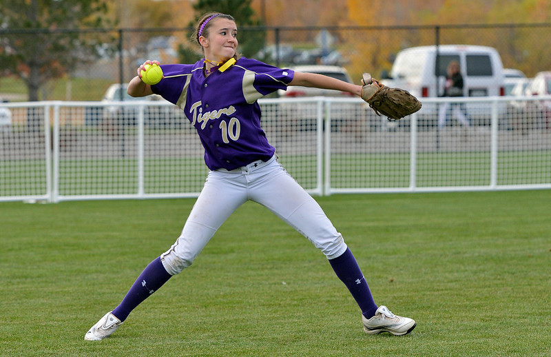 Holy Family's Macy Cox throws the ball to the infield after scooping up a Valley hit during Saturday's state semi final softball championship game at Aurora Sports Park.<br /> <br /> October 20, 2012<br /> staff photo/ David R. Jennings