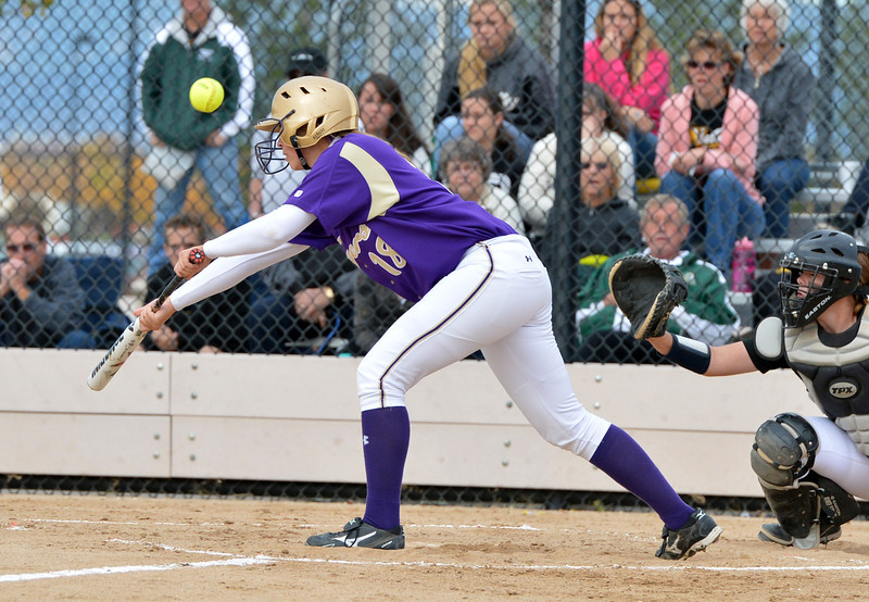 Holy Family's Nicole Gardon bunts the ball against Valley  during Saturday's state semi final 3A softball championship game at Aurora Sports Park.<br /> <br /> October 20, 2012<br /> staff photo/ David R. Jennings