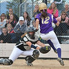 Holy Family's Maeve Donovan jumps past the reach of  Valley's catcher Sami Gill during Saturday's state semi final softball championship game at Aurora Sports Park.<br /> <br /> October 20, 2012<br /> staff photo/ David R. Jennings